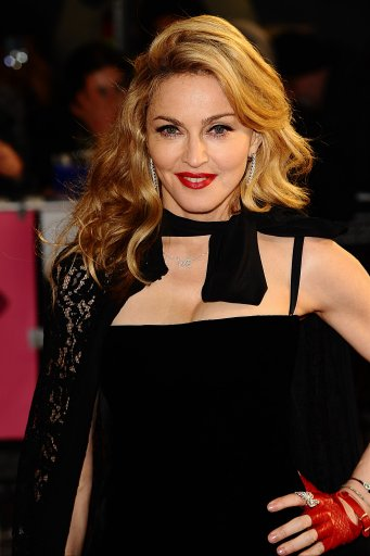 Madonna looks fabulous in velvet and lace as she attends W.E. UK premiere