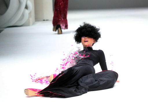 Model Does A Naomi Campbell as she dramatically falls during French Couture Singapore Fashion Show